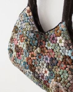 This is so neat with who knows how many 6 petal puff Mollie flowers...looks like merino wool.  The link has a vid but this link has a chart of the Mollie: http://www.tejiendoperu.com/crochet/bolso-con-mollie-flowers/