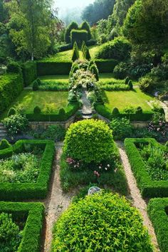 Classic English Garden: Knot Garden The knot garden behind the house features arches of roses and clematis.