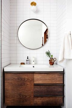 Looking for small bathroom ideas? Take a look at our best small bathroom design ideas to inspire you before you start redecorating your small Small Bathroom, Wood Bathroom, Bathroom Inspiration, Bathroom Decor, Wood Bathroom Vanity, Round Mirror Bathroom, Tile Bathroom, Laundry In Bathroom, Home Decor