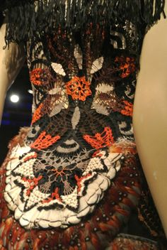 Detail of crochet feather dress by Gaultier