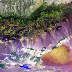 Bogda Mountains  The Turpan Depression, nestled at the foot of China's Bogda Mountains, is a strange mix of salt lakes and sand dunes. It is one of the few landscapes in the world that lies below sea level.