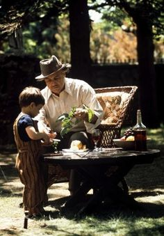 """The Godfather"". Marlon Brando with his character Vito's grandson among the vegetables and citrus."