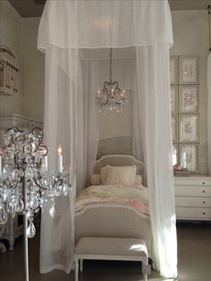 Gorgeous French Bedroom with a luxuriously canopied upholstered bed