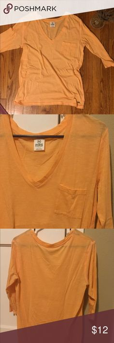 •Pink• V-Neck Lounge Tee Shirt is so comfortable!! Sleeves are 3/4 length. Material is soft, light weight & fits loose. Have worn this as a sleep shirt and also out with joggers/shorts & a bandeau for daytime wear. Color is a light orange. Victoria's Secret Tops Tees - Long Sleeve