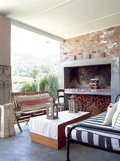 A cosy, homely patio and braai area. The concrete and brickwork look great toget… - Outdoor Rooms, Outdoor Areas, Outdoor Living, Outdoor Furniture Sets, Built In Braai, Home Fireplace, Fireplaces, Outdoor Fire, Cozy House
