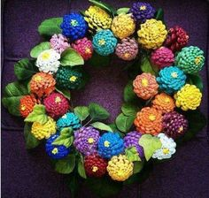 What a great Spring wreath / wall hanging - made from pine cones!