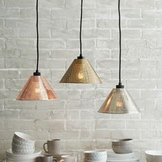 Shine a light over a kitchen island with these Perforated Metal Industrial Pendants. Whether you hang them alone or cluster a few above a kitchen island, they look great paired with Tall Edison Bulbs.