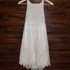 """DOLCE VITA Lace Dress Embroidered Vintage Mini Size Small New With Tags $242.00   Color: White/Natural  Embroidered lace dress featuring vintage crochet detailing, halter neckline and side zip closure. 70% cotton, 30% silk  Measurements for Small: Bust: 34.5""""  Waist: 27.5""""  Hip: 37.5""""  Length: 31""""    ❗️ Please - no trades, PP, holds, or Modeling.   ✔️ Reasonable offers considered when submitted using the blue """"offer"""" button.   💰 Bundle 2+ items for a 20% discount!   👠 Stop by my closet for…"""