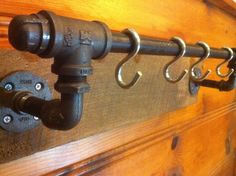 Industrial Pipe and Barn Wood - Coat Hooks / Towel Bar / Pot Hooks. $40.00, via Etsy...Pre-made, no plumber or plumbing skill required!