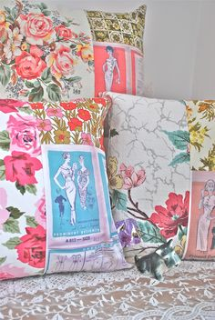 pillows made from assorted vintage fabrics, linens, etc. and vintage pattern graphics from patterns that were my mom's.