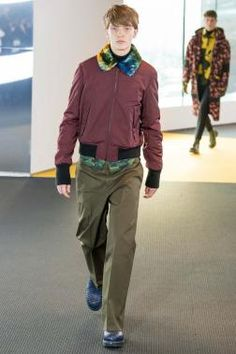 For the Fall-Winter 2015 KENZO Menswear collection we look towards individuality, survival, protection and the functional. We welcome the unknown with inimitable curiosity. We celebrate the signs of others and observe symbolism as communication through cult scribbles, care labels and unique prints. We are a community.