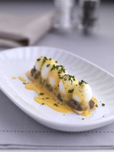 Feuillete roughly translates as 'leaves', represented in this dish by the layers of puff pastry. The addition of Madeira to the pastry lends this quail egg recipe from Geoffrey Smeddle an enticing sweetness, particularly when smothered with hollandaise sauce. Quail eggs can be difficult to peel, so it's best to boil a few extra and to use up any broken ones in a salad or sandwich. This is delicious served as a starter.