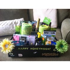 Honeymoon basket with magazines, beach towels, champagne, chocolates, dsw gift card, bridal emergency kit, heart wine stopper, mr. and mrs. luggage tags, airplane bottles, peanuts, vacation mad libs, underwater camera, tanning lotion, aloe vera