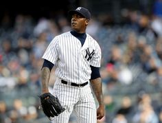 Aroldis Chapman Photos Photos - Aroldis Chapman #54 of the New York Yankees reacts to the final out of the game against the Chicago White Sox at Yankee Stadium on May 15, 2016 in the Bronx borough of New York City.The New York Yankees defeated the Chicago White Sox 7-5. - Chicago White Sox v New York Yankees