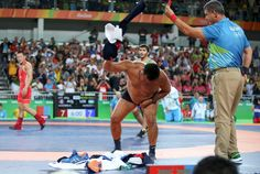 coach of Mandakhnaran Ganzorig of Mongolia takes off his clothes as he protests after the Bronze Medal match against Ikhtiyor Navruzov of Uzbekistan in Men's Freestyle Wrestling 65 kg Katie Ledecky, Basketball Court, Soccer, Rio 2016, Rhythmic Gymnastics, Mongolia, Olympic Games, Triathlon, Sports And Politics
