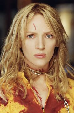Uma Thurman in Kill Bill. I'm watching the movie right now, and THAT awesome yellow jumpsuit - ugh so cool. But before big fight, when she's calling O-Ren out, her hair looks amazing.