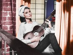 """Holly Golightly (Audrey Hepburn) singing Moon River in """"Breakfast at Tiffany's. George Peppard, Holly Golightly, Diane Arbus, Breakfast At Tiffany's, Breakfast With Tiffany, Audrey Hepburn Pictures, Audrey Hepburn Breakfast At Tiffanys, Blake Edwards, Excuse Moi"""