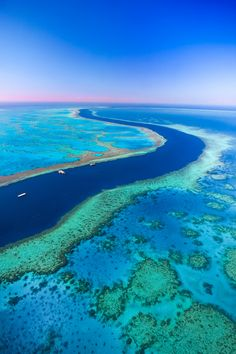 Going with the Flow by Jill Fisher on 500px.  Over Hardy Reef, Great Barrier Reef, Queensland Australia.  It's easy to understand why the Great Barrier Reef is one of the seven natural wonders of the world.  The amazing contrast of colors is something that's best experienced from the air.  It's larger than the Great Wall of China and the only living thing on earth visible from space.