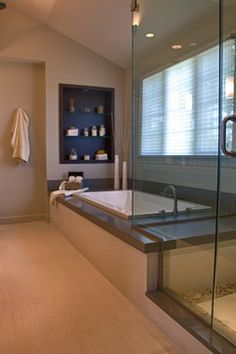 Master Bath: Tub/Shower transition, no interruptions. Makes the space appear open and larger.
