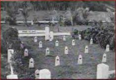 """Among the many Marine casualties in Guam were 25 dogs, most of them Dobermans. Upon their deaths, the dogs were taken back to the initial invasion beach and interred in a small section of the Marine Cemetery. Later small white headstones with their names were erected and it became known as """"The War Dog Cemetery"""".  Indeed, the War Dog Memorial and Cemetery on Guam is the most unique of all the dog memorials because it encompasses the dogs' actual resting place."""