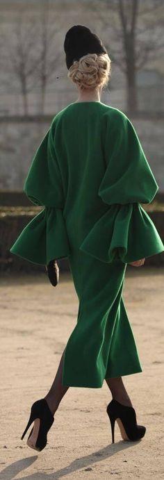 Green coat black hat