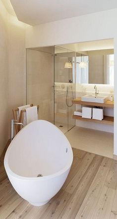 A pretty simple wooden bathroom. I would like it even without the bathtub