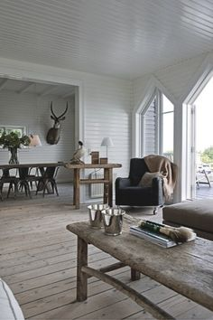 Jesper Ray / Bolig Magasinet {white and wood rustic modern living room} by recent settlers, via Flickr....I like minus the deer head and stuffed bird.