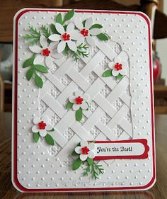 mostly white card with a trellace made from paper strips...like the punched flowers...