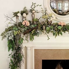 Lush natural garland accented with reflective vases can help take any mantle or fireplace into the winter season.