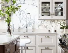 """The backsplash slab is stunning.  It amazes me what we can find in nature! Martin Moore & Co. """"modernist"""" cabinetry."""