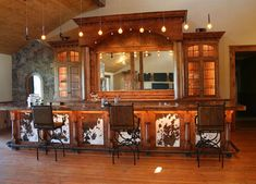 Fun! If this isn't western, I don't know what is! Love the cowhide panels maybe on a wet bar?