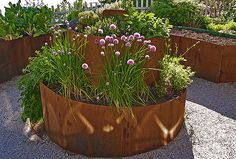 If space is an issue the answer is to use garden boxes. In this article we will show you how all about making raised garden boxes the easy way. We all want to make our gardens look beautiful and more appealing. Herb Spiral, Spiral Garden, Herb Garden, Vegetable Garden, Garden Edging, Potager Garden, Veggie Gardens, Garden Path, Easy Garden