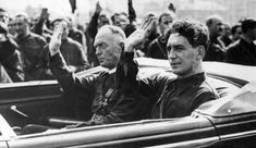 General Ion Antonescu and Horia Sima, the Romanian Iron Guard Leader, in a limousine, both wearing the green Iron Guard uniform and heiling the crowds as they drive through the streets of Bucharest. Get premium, high resolution news photos at Getty Images