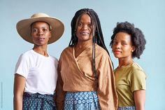 Three South African sisters stand together wearing modern traditional Shweshwe skirts against a blue background. Shweshwe is a traditional South African print style in clothing. African Print Fashion, Fashion Prints, Modern Traditional, Blue Backgrounds, Third, Sisters, The Unit, Stock Photos, Portrait