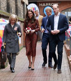 Catherine, Duchess of Cambridge and Prince William, Duke of Cambridge with Prince Harry attend a Christmas party for volunteers at The Mix youth service on December 19, 2016 in London.