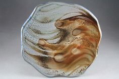 Discover Local Artists: Ceramics Holiday Sale | Christine Davis . Soda-fired cheese plate by Ellen Bates.
