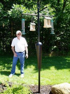 Bird feeder pole with squirrel baffle woodworking for Bird feeder pole plans