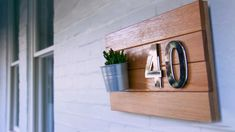 If your facade needs more character, an eye-catching house number will do just the trick. A bold house number makes it easier for visitors to find your home, and also gives it a sense of identity. Floating Nightstand, Floating Shelves, Types Of Timber, Timber Slats, Exterior Stain, Masonry Wall, Local Hardware Store, Timber House, Succulent Pots