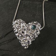 Fine silver and natural blue zircon