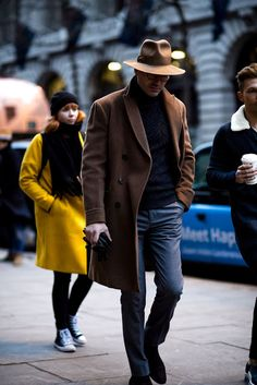 Fedora with rolled neck sweater and camel overcoat