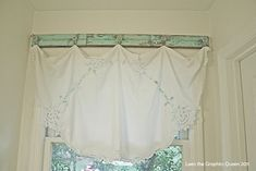 Old wood and knobs for a simple shabby chic window treatment. I Love this, easy and inexpensive.