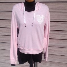 PINK VS Light pink hoodie. Heart on front. PINK spelled out on back. Pockets on the sides. True to size. Excellent condition. PINK Victoria's Secret Tops Sweatshirts & Hoodies