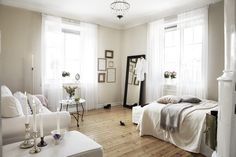 Vardagsrum Fantastic Frank loft apartment with white bed and linens