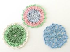 These delightful doilies were hand crocheted in fresh green, happy pink and beautiful blue. The doilies work either as embellishments or as coasters! They measure 3.5 - 3.75 inches (8.9 - 9.5 cm).  Find more doilies here: http://www.etsy.com/shop/ByTheBy?section_id=  Thanks for looking! I am happy to answer questions :) Jaci ByTheBy.etsy.com  Made in a smoke-free, cat-loving home, with cat assistance :)  Indiana sales tax added to all purchases by Indiana residents. 16