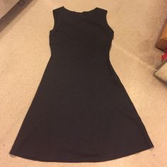 Black work dress Simple and chic basic dress to accessorize. Side zipper. Perfect for work or an event. Material is wool blend but feels like your typical dress pant material Calvin Klein Dresses