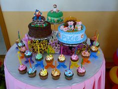 """Nursery Rhyme cake for my daughter's 18th birthday party. The theme of the party was """"Children's Book Characters"""". Cupcakes held the individual candles which she blew out after 18 wishes were made in her behakf."""