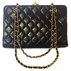 2ec048e186d7 Vintage CHANEL black leather chain shoulder bag with golden CC kiss lock  closure
