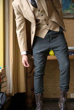 Shop this look on Lookastic:  https://lookastic.com/men/looks/blazer-waistcoat-dress-shirt-sweatpants-boots-tie/13359  — White Dress Shirt  — Grey Horizontal Striped Tie  — Tan Waistcoat  — Tan Blazer  — Charcoal Sweatpants  — Dark Brown Leather Boots