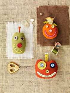 Cute Pumpkin Pincushions.....I'm thinking making them into cute pins to wear.....maybe on a jean jacket!