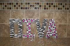 Diva Birthday party: Cheetah and zebra print painted letters